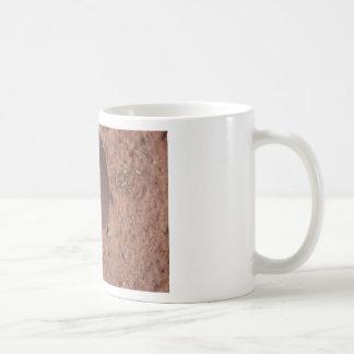 shovel and flower mug