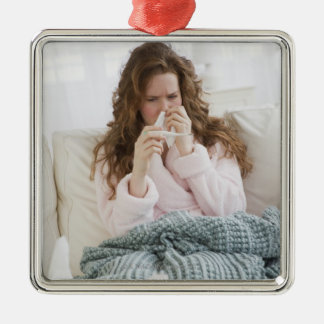 Sick woman on couch metal ornament