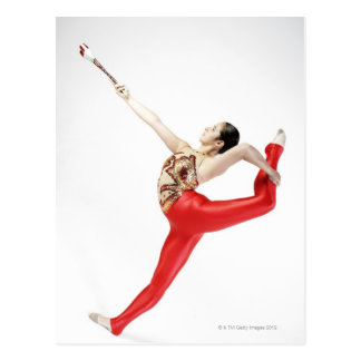 Side profile of a female gymnast practicing postcard