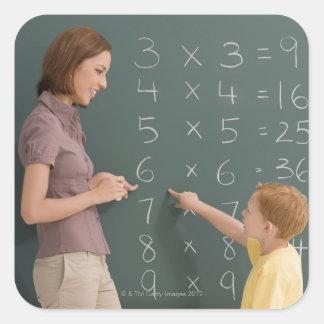 Side profile of a female teacher teaching her square sticker