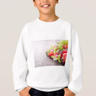 Side view of a plate of fresh salad closeup sweatshirt