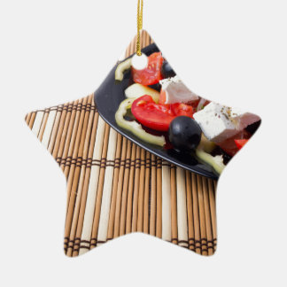 Side view of fresh vegetarian salad on plate ceramic star decoration