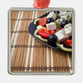 Side view of fresh vegetarian salad on plate Silver-Colored square decoration