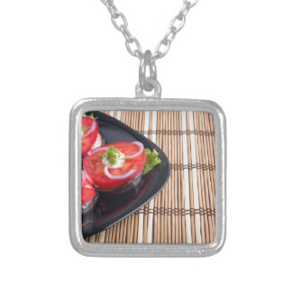 Side view of the cut slices of red tomatoes silver plated necklace