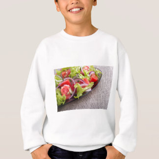 Side view on a diagonal on a plate with salad sweatshirt