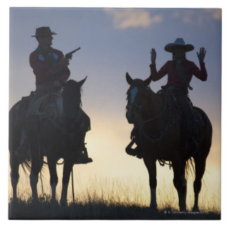 Silhouette of a Cowboy targeting his pistol to a Tile