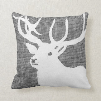 Silhouette of a white deer on a soft grey bckgrnd cushion