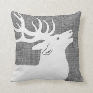 Silhouette of a white elk on a soft grey bckgrnd cushion