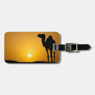 Silhouette of a wild camel at sunset luggage tag