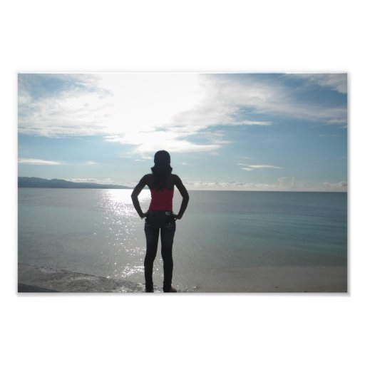 Silhouette of a woman in the sunset photographic print