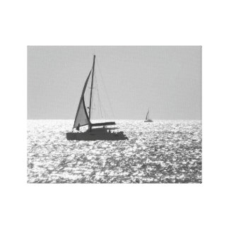 Silhouette of a yacht in the sea. canvas print
