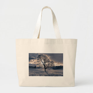 Silhouette of an old Oak tree Tote Bags