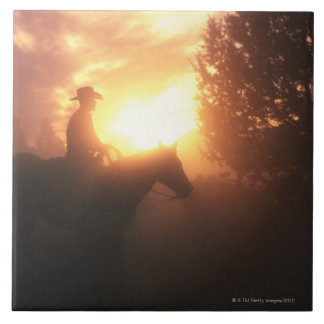 Silhouette of cowboy on a horse tile
