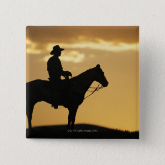 Silhouette of cowboy on horseback at sunset or 15 cm square badge