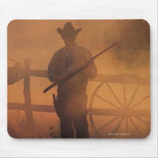 Silhouette of cowboy with rifle in hand mouse pad