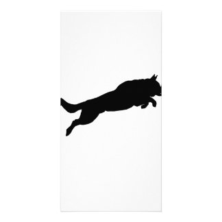 Silhouette of German Shepherd Dog Jumping over Picture Card