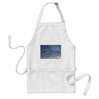 Silhouette of grass at sunset aprons