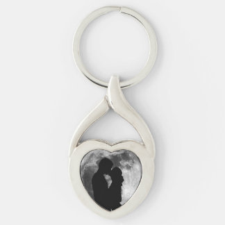 Silhouette of lovers in a full moon at night key ring