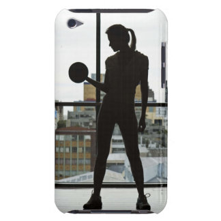 Silhouette of woman lifting weights at gym barely there iPod cover