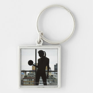 Silhouette of woman lifting weights at gym key chain