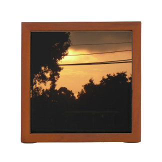silhouette trees orange sunrise at dawn desk organiser