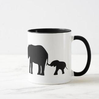 Silhouettes of 3 Elephants Holding Tails Mug