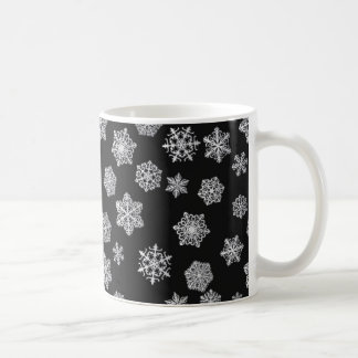 Silver snowflakes on a black background coffee mug