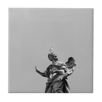 Simple, modern photo of seagull on top of statue ceramic tile