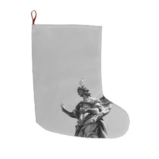 Simple, modern photo of seagull on top of statue large christmas stocking