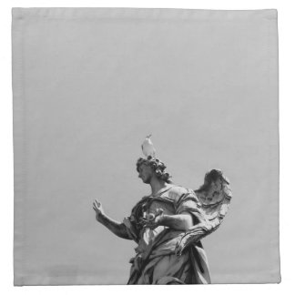 Simple, modern photo of seagull on top of statue napkin