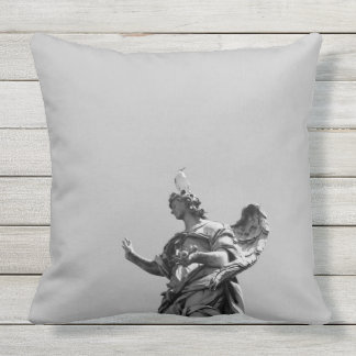 Simple, modern photo of seagull on top of statue outdoor cushion