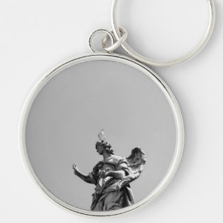 Simple, modern photo of seagull on top of statue Silver-Colored round key ring