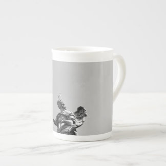 Simple, modern photo of seagull on top of statue tea cup