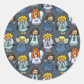 singing angels on blue background round sticker