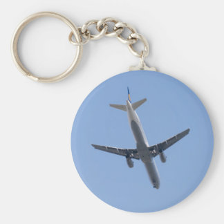Single airplane on the blue sky background basic round button key ring