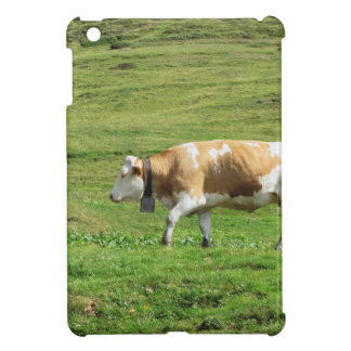 Single cow in an alpine pasture iPad mini covers