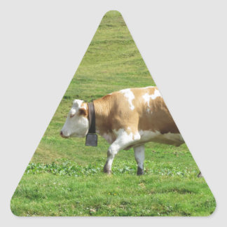 Single cow in an alpine pasture triangle sticker