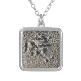 Single footprint of seagull bird on beach sand silver plated necklace