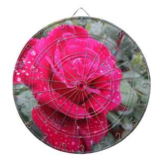 Single red rose flower with water droplets dartboard