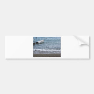 Single rowing boat moored in a harbor on the sea bumper sticker