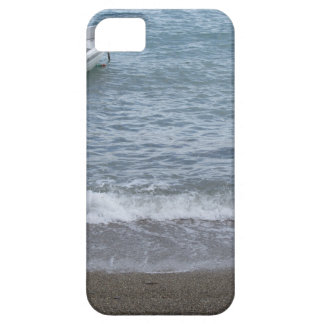 Single rowing boat moored in a harbor on the sea iPhone 5 case