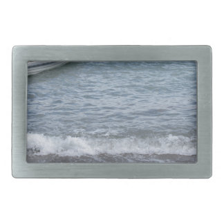 Single rowing boat moored in a harbor on the sea rectangular belt buckle