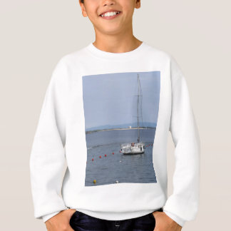 Single sailboat lies at anchor in a harbor sweatshirt