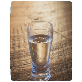 Single shot of Tequila on wood table iPad Cover