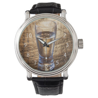 Single shot of Tequila on wood table Watches