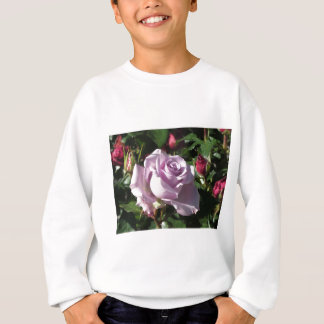 Single violet rose flower with red roses around sweatshirt