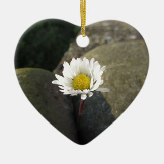 Single white daisy flower between the stones ceramic heart decoration