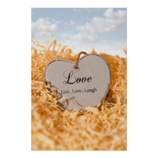 single wooden heart in a love nest posters