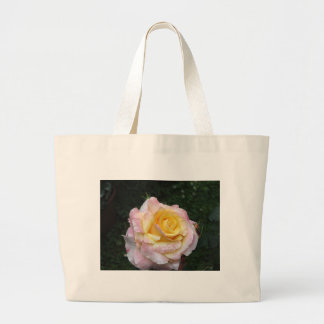 Single yellow rose flower with water droplets large tote bag
