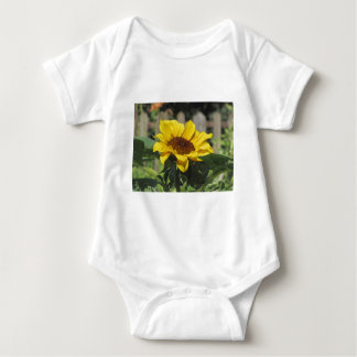 Single yellow sunflower with green leaves baby bodysuit